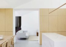Wood-on-the-walls-and-the-dining-table-bring-contrast-and-warmth-to-the-clean-space-in-white-56388-217x155