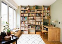 Wooden-shelves-rug-and-desk-bring-a-sense-of-timeless-charm-to-this-vintage-home-office-22019-217x155