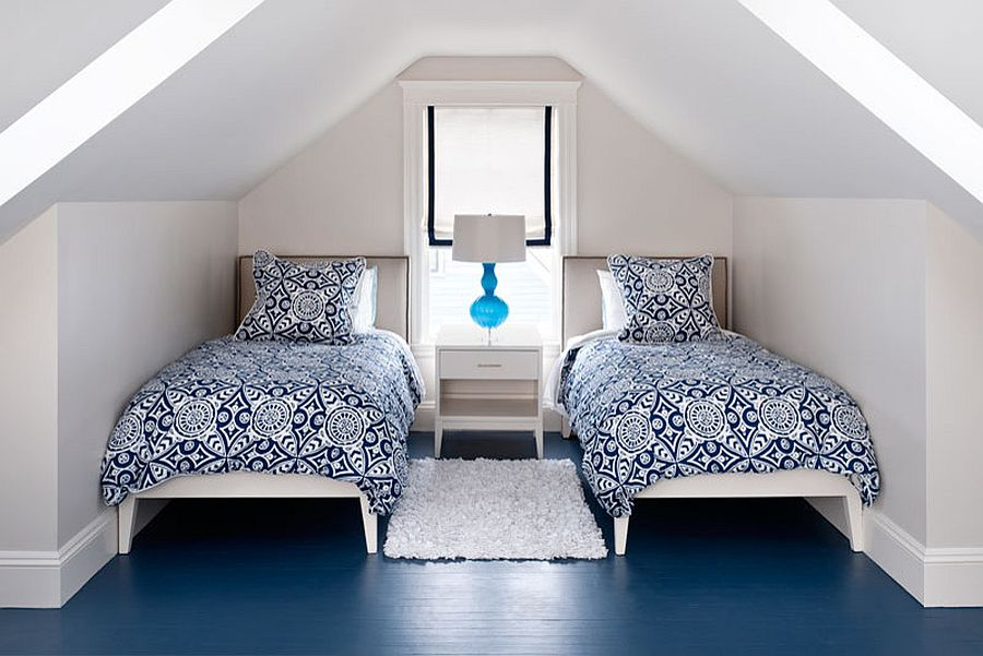 Attic bedroom in modern beach style with painted floor in blue