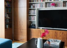 Awesome-book-and-DVD-collection-finds-perfect-space-in-the-large-living-room-booshelf-70208-217x155