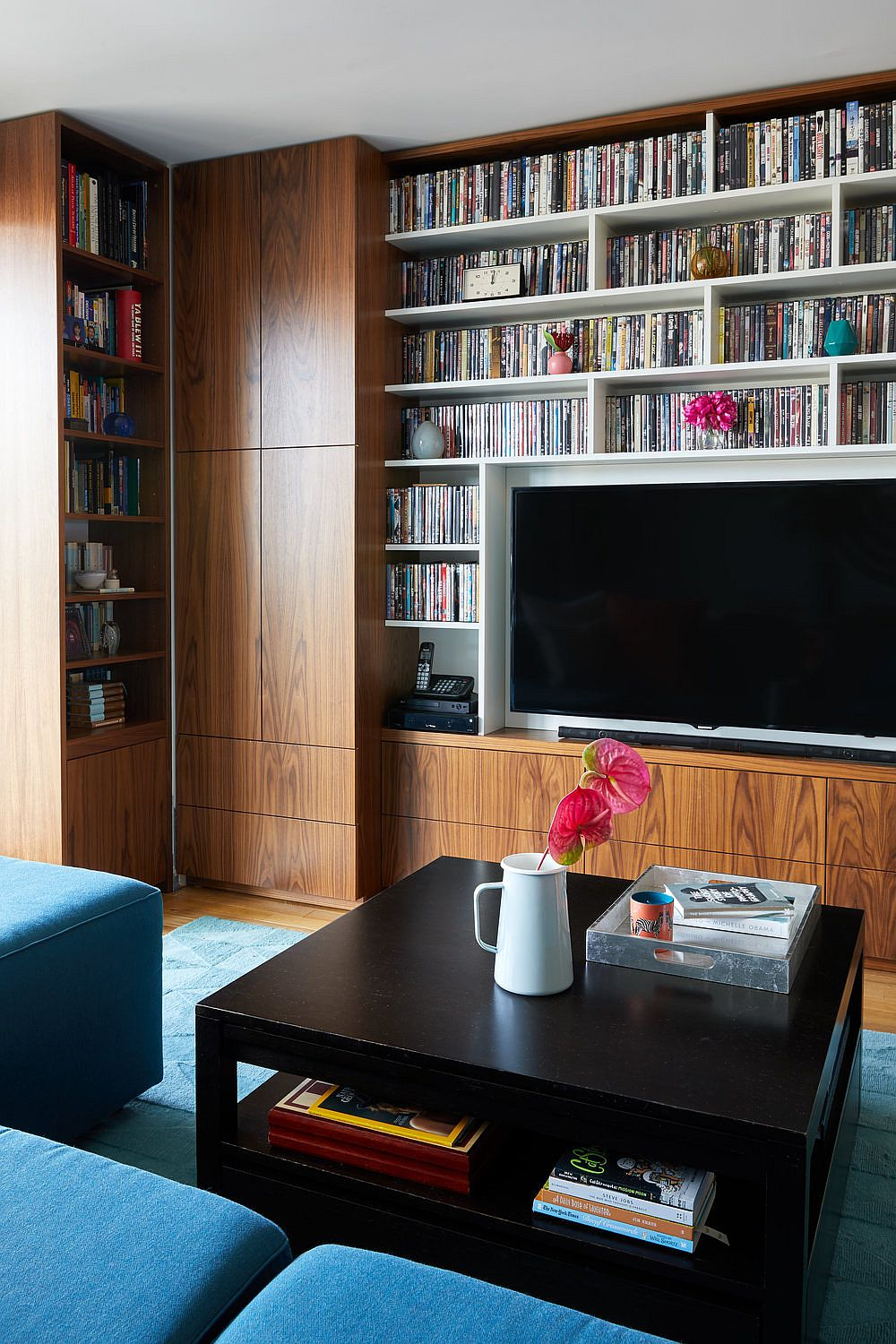 Awesome book and DVD collection finds perfect space in the large living room booshelf