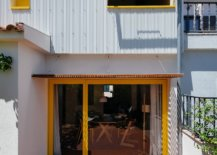 Backyard-of-the-house-is-connected-with-the-interior-using-sliding-glass-doors-that-have-a-bright-yellow-frame-15032-217x155