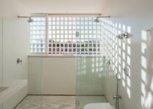 Bathroom-in-white-with-ample-natural-light-and-glass-shower-zone-32328-217x155