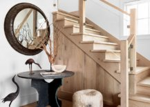 Beach-style-entry-to-the-bungalow-with-a-vintage-console-table-round-mirror-and-staircase-leading-to-the-upper-level-40810-217x155