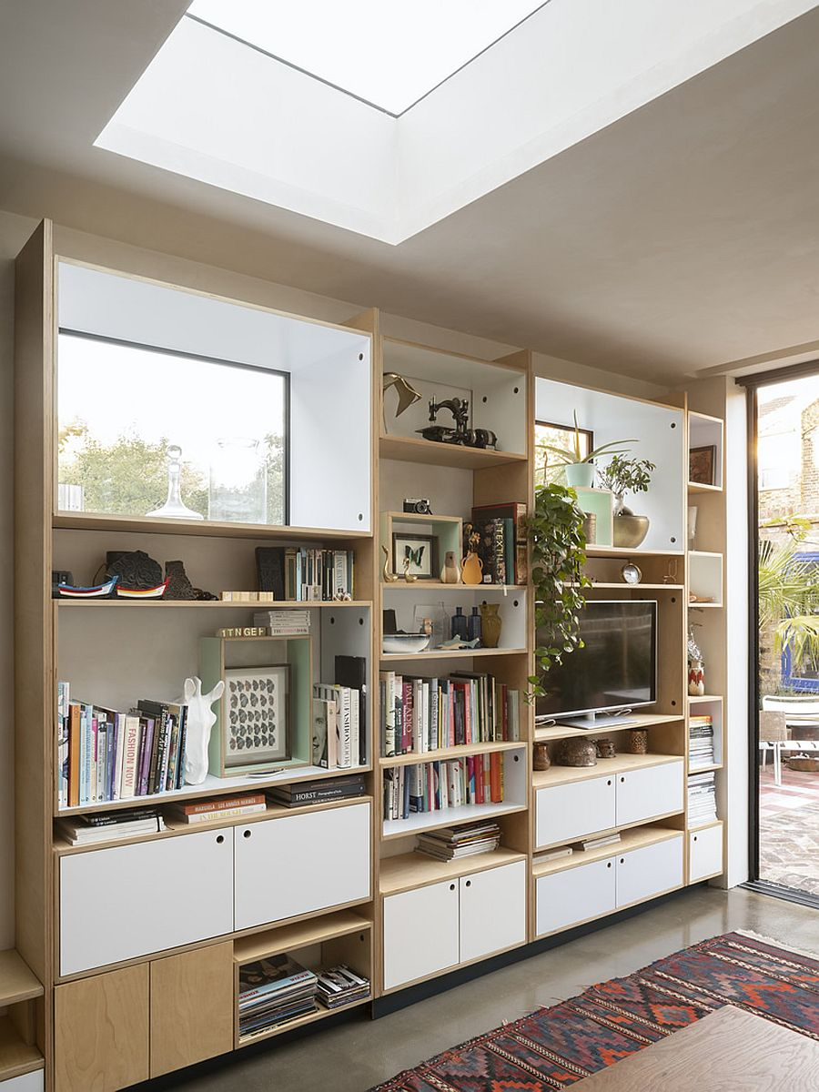 Birch plywood shelves and skylight combine to create an organized and cheerful interior