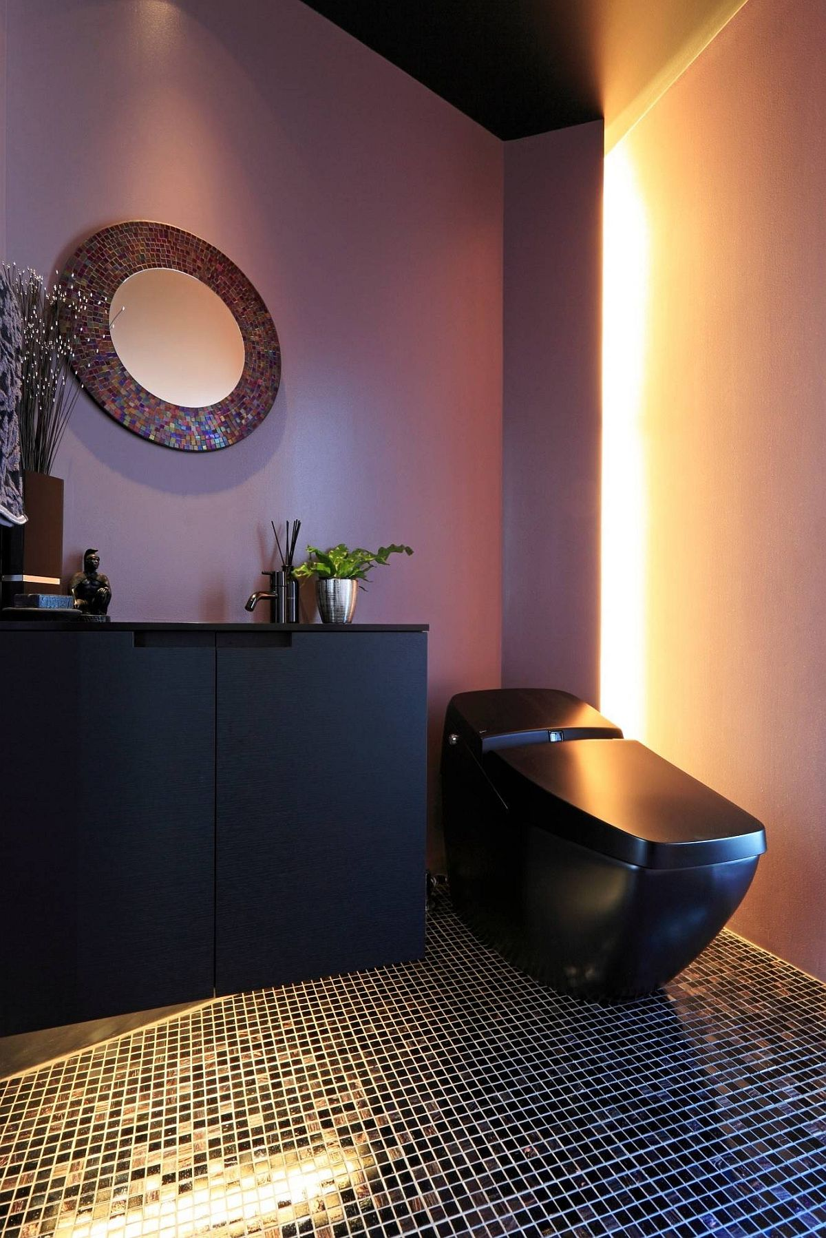 Black combined with purple in the spacious powder room