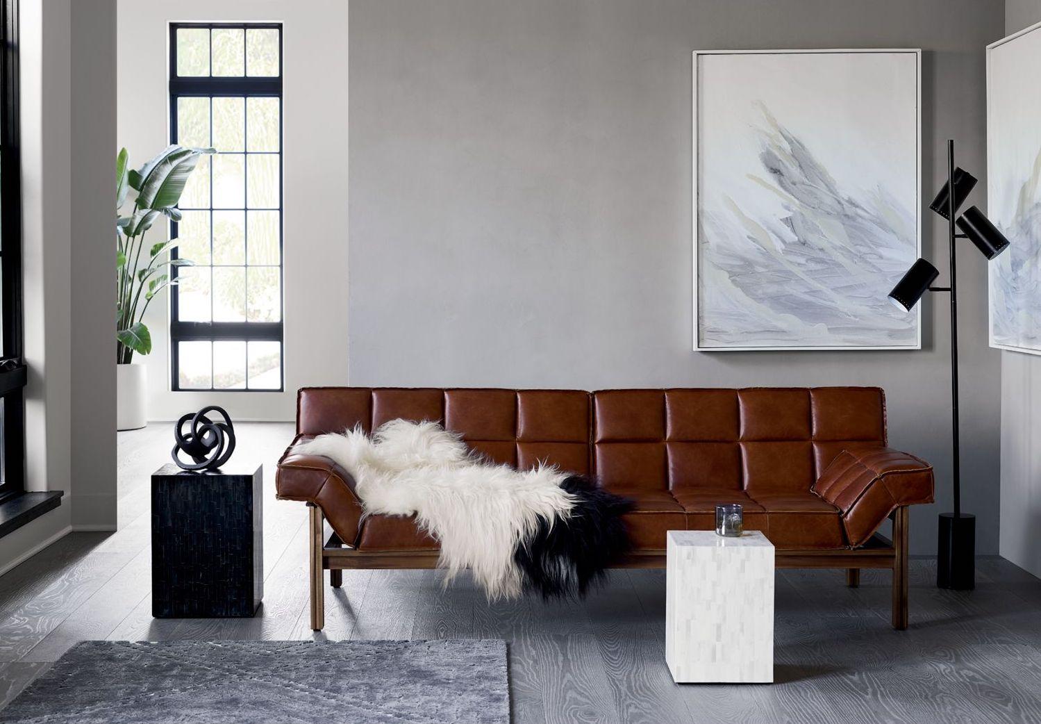 Black knot sculpture in a modern room