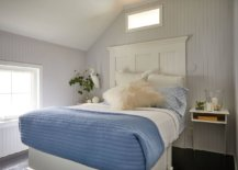 Black-painted-floor-adds-contrast-to-the-modern-coastal-bedroom-in-white-with-blue-bedding-65118-217x155
