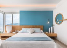 Blue-accent-wall-for-the-white-bedroom-with-ocean-views-65644-217x155