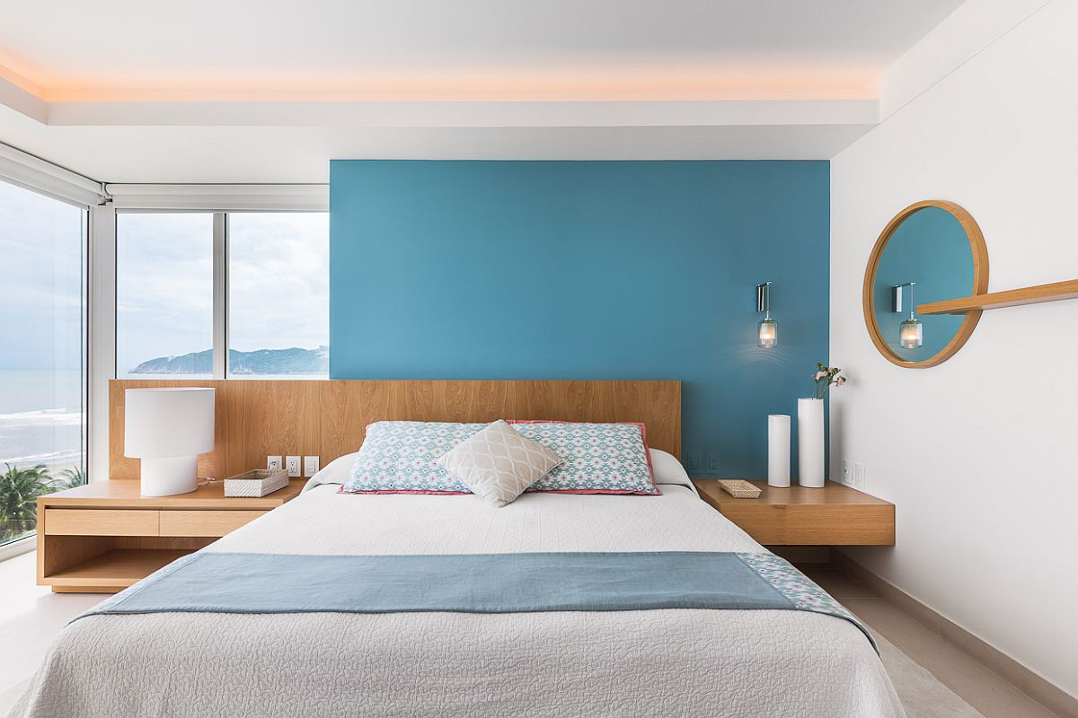 Blue-accent-wall-for-the-white-bedroom-with-ocean-views-65644