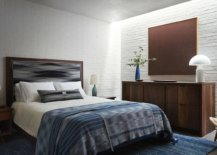 Blue-accents-wooden-decor-and-whitewashed-brick-walls-create-a-cozy-relaxing-bedroom-28794-217x155