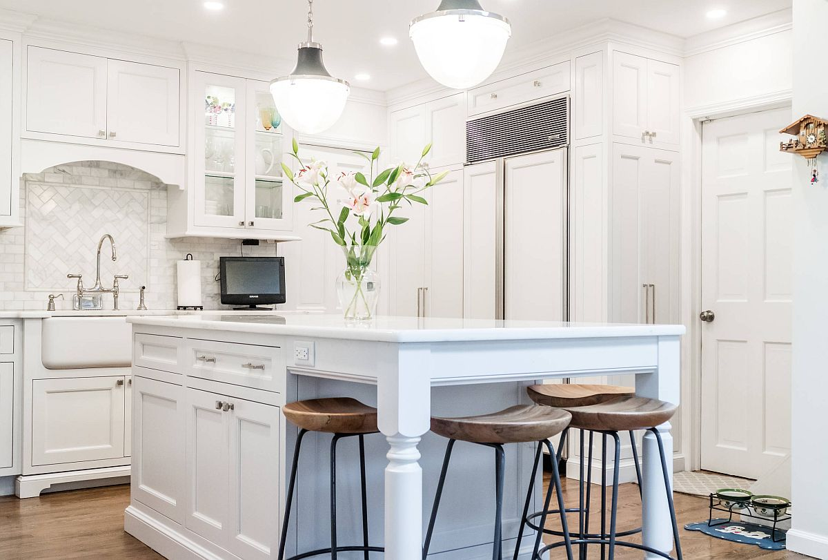 Blue-block-of-the-kitchen-island-is-the-only-color-you-find-in-this-white-transitional-style-kitchen-62516