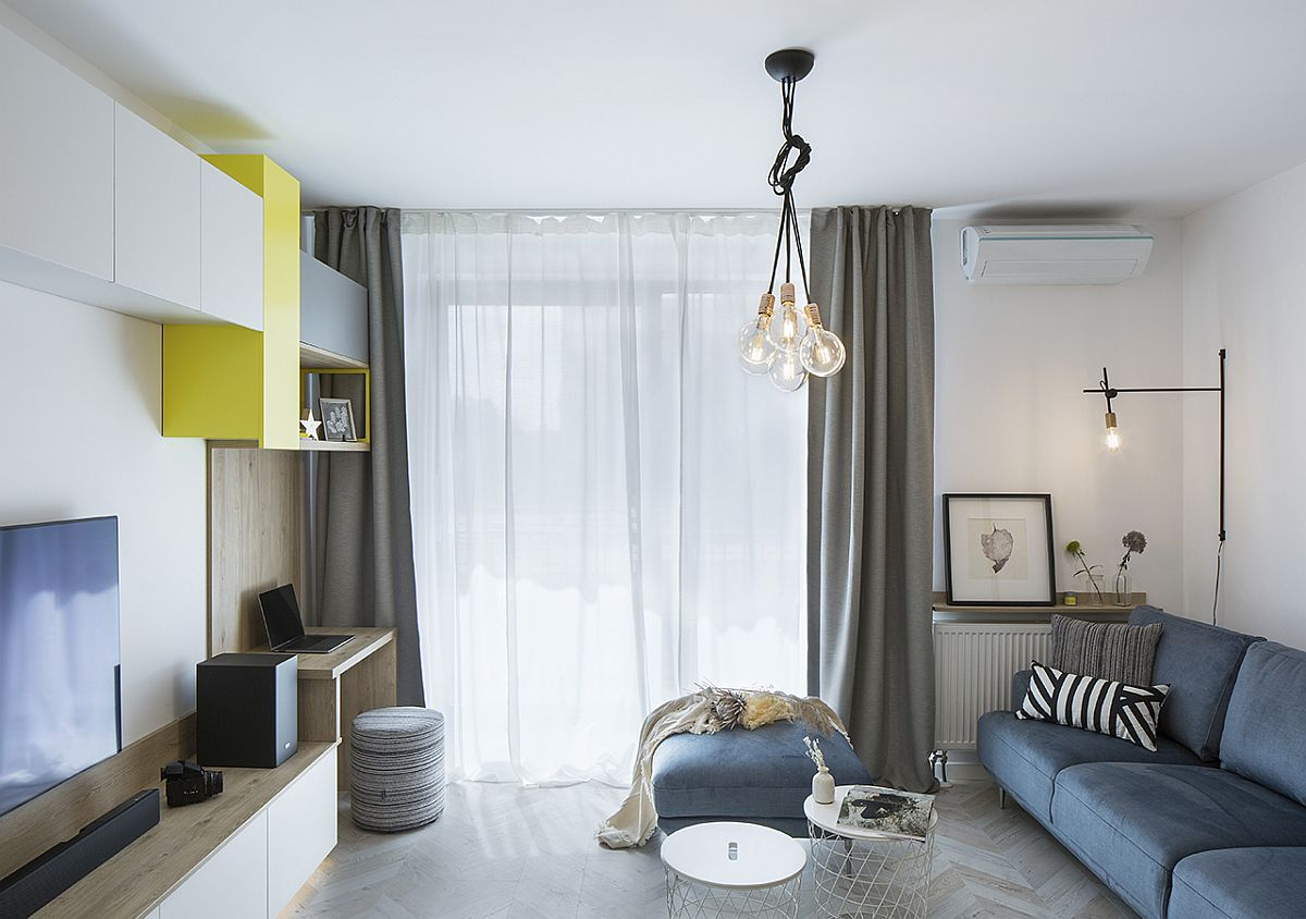 Blue sofa, yellow cabinets and gray drapes for the modern living room in white