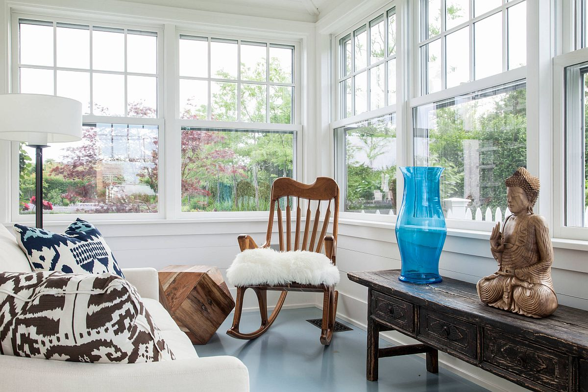Blue wood painted floor in the small beach style bedroom with ample natural light
