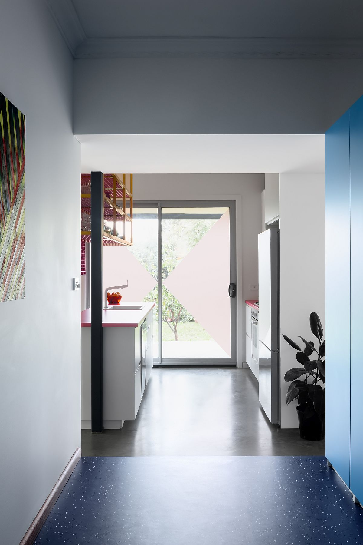 Bright-blue-floor-and-storage-units-give-the-interior-a-more-cheerful-appeal-60319