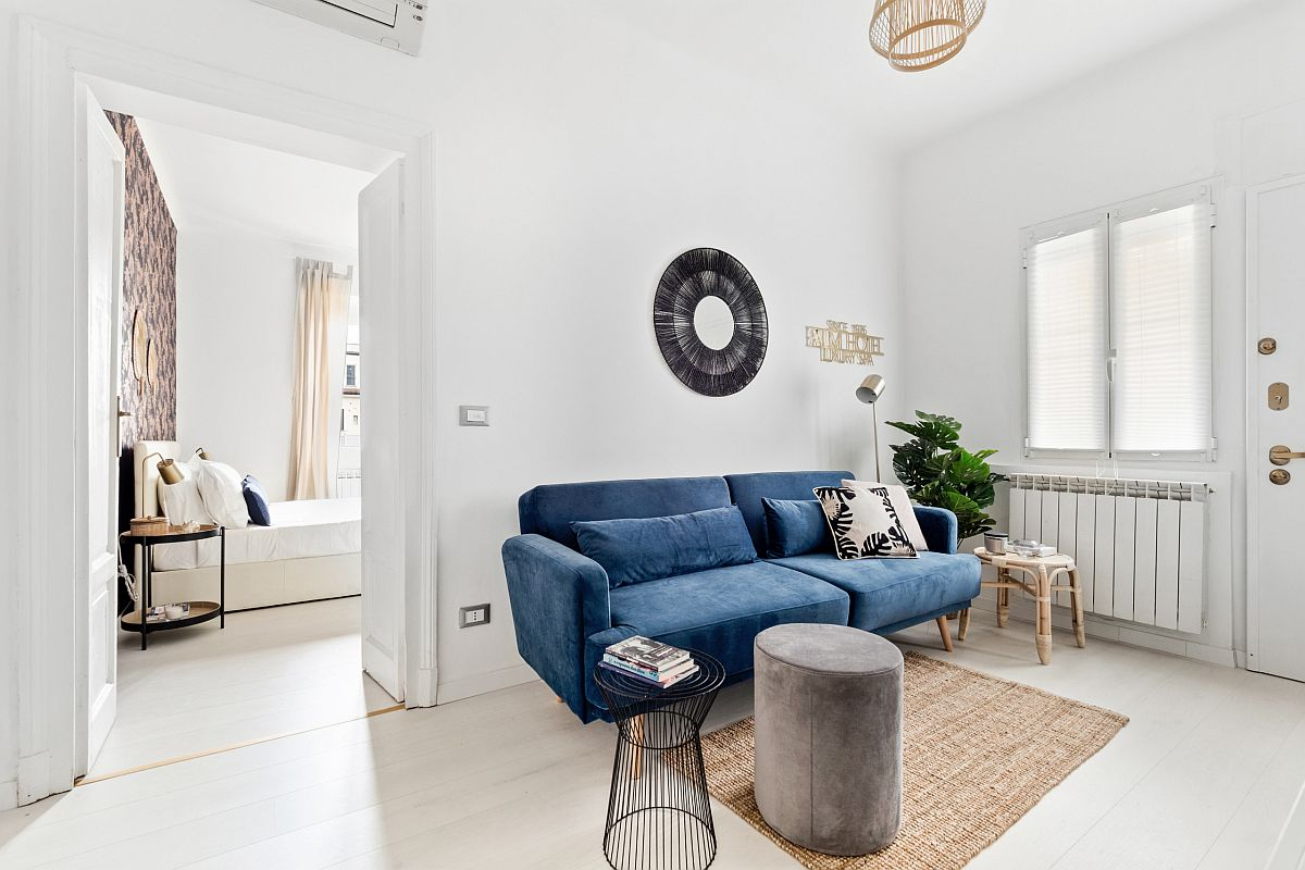 Bright blue sofa is the perfect choice for the small modern living room in white