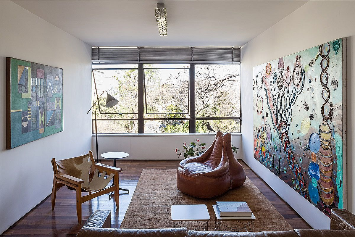 Brilliant art work and decor from Brazilian masters steals the show inside this revamped apartment