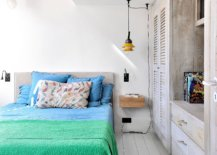 Brilliant-use-of-colorful-bedding-brings-life-to-this-monochromatic-bedroom-in-white-86039-217x155