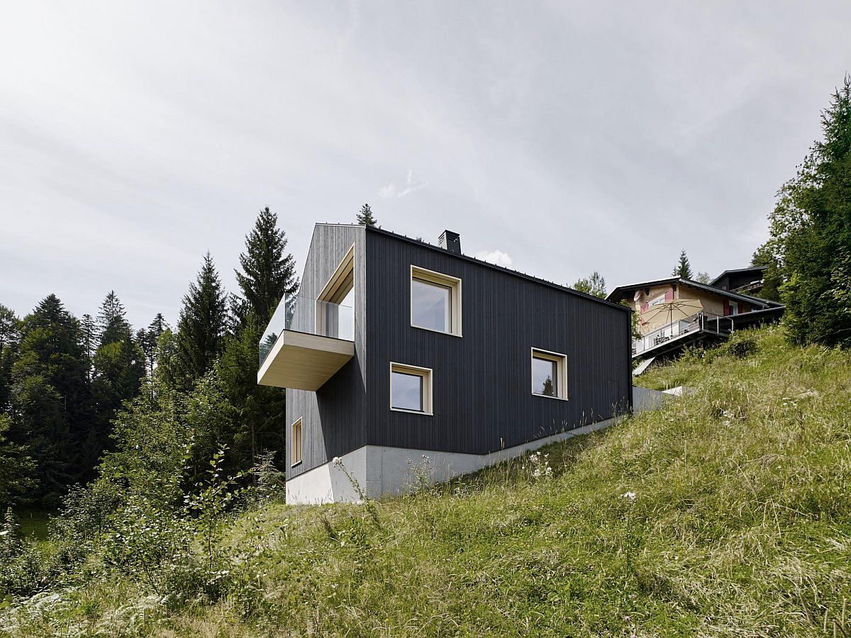 Building on the sloped site overlooks the lovely valley below and the forest beyond it in Austria