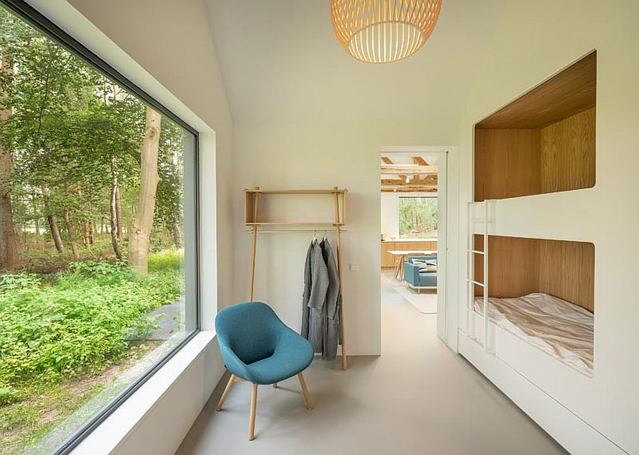Bunk beds with large picture window on the opposite side offer lovely view of the outdoors