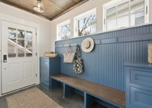 Cabinets-in-blue-at-both-ends-of-the-bench-along-with-the-wall-in-the-backdrop-add-color-to-this-white-coastal-mudroom-32556-217x155