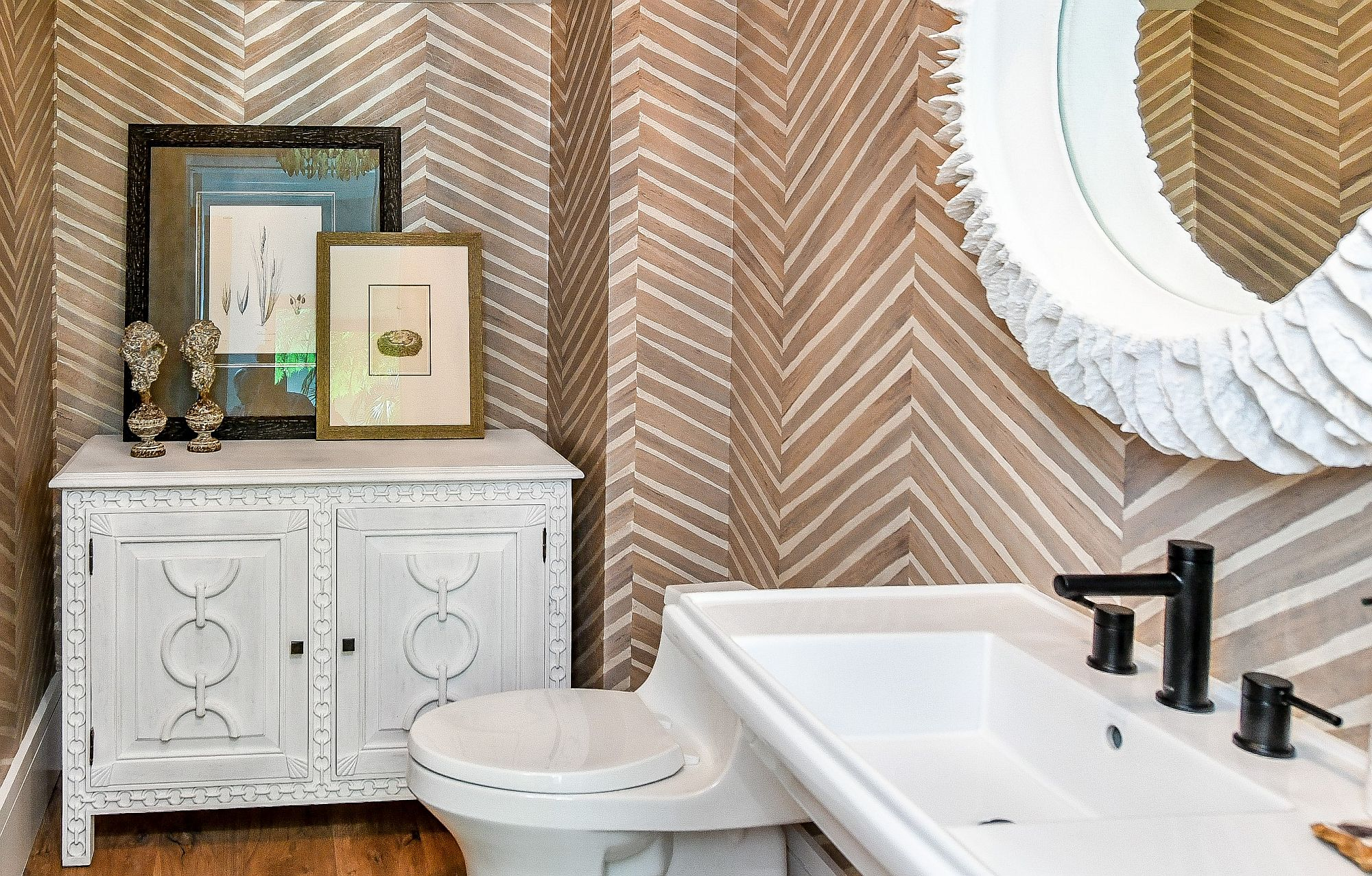 Chevron pattern on the walls makes the biggest impact in this small powder room