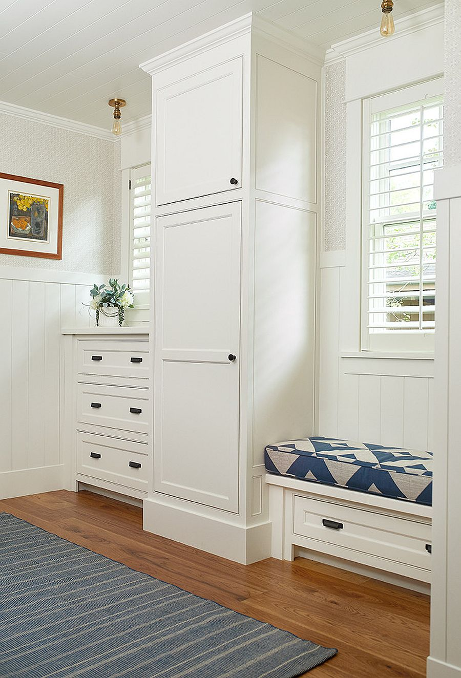 Closed-cabinets-storage-units-and-a-lovely-little-bench-in-the-mudroom-work-better-in-a-home-without-kids-50437