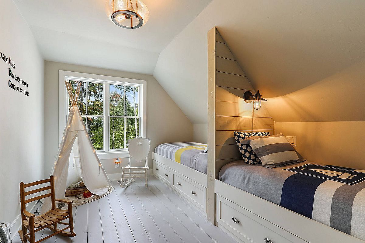 Coastal themed kids' bedroom with bunk beds and wooden floor painted in white