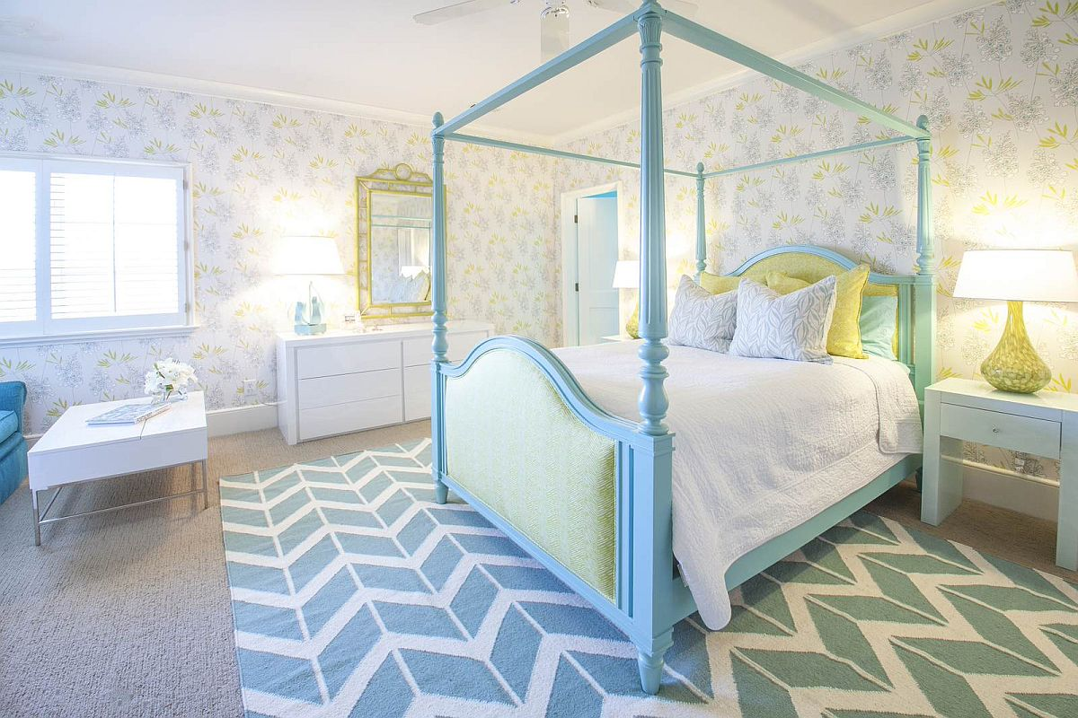 Colorful girls' bedroom with light blue for-poster queen size bed and a rug with chevron pattern