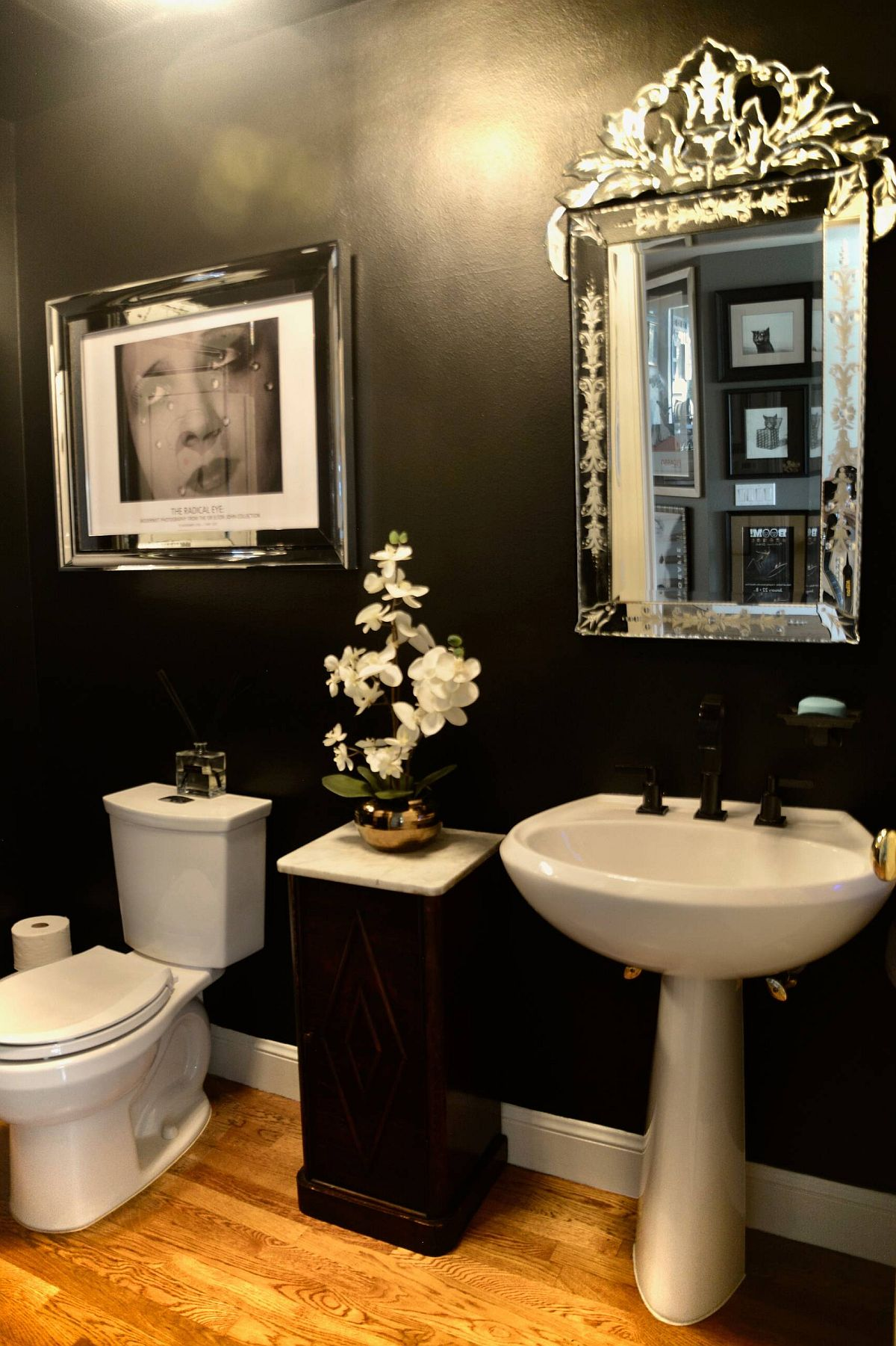Combine a bit of classic charm with the contemporary black powder room