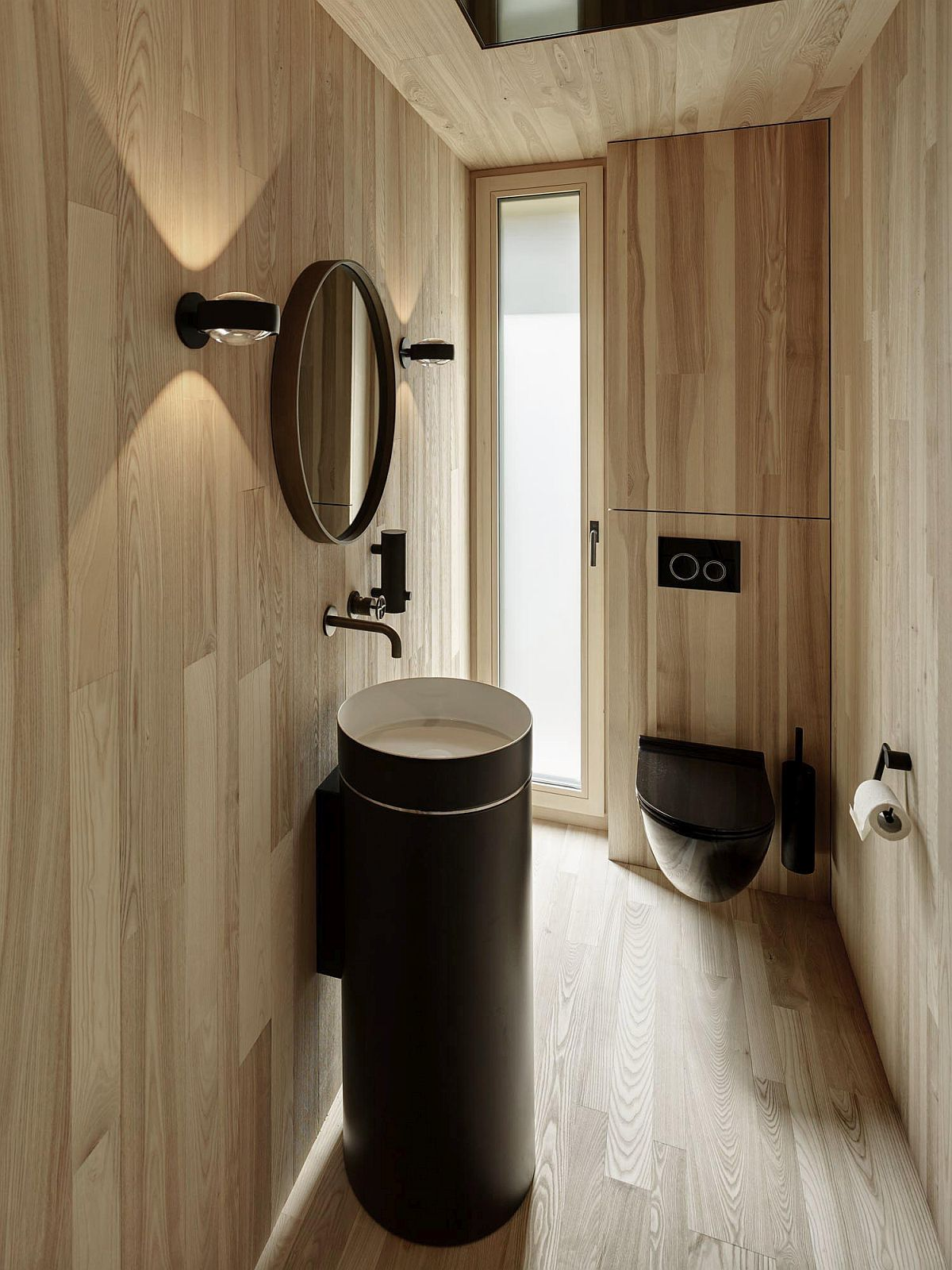 Contemporary bathroom fittings are combined with wooden walls to create an exceptional bathroom