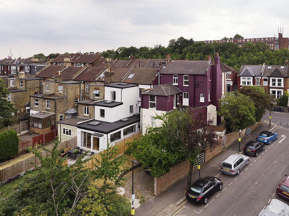 Contemporary makeover of the multi-tiered Victorian home in North London is apparent even from a distance