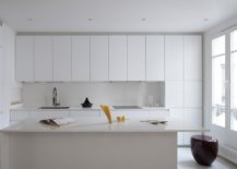 Contemporary-monochromatic-kitchen-in-white-with-ample-shelf-space-and-a-fabulous-central-island-36039-217x155