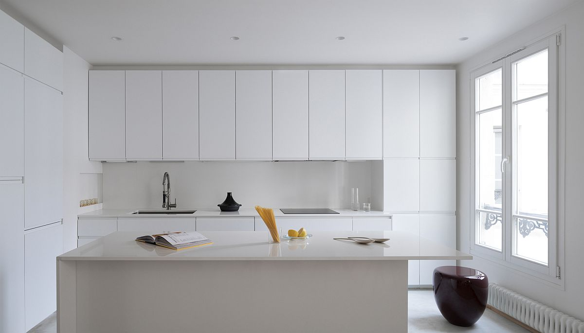 Contemporary-monochromatic-kitchen-in-white-with-ample-shelf-space-and-a-fabulous-central-island-36039