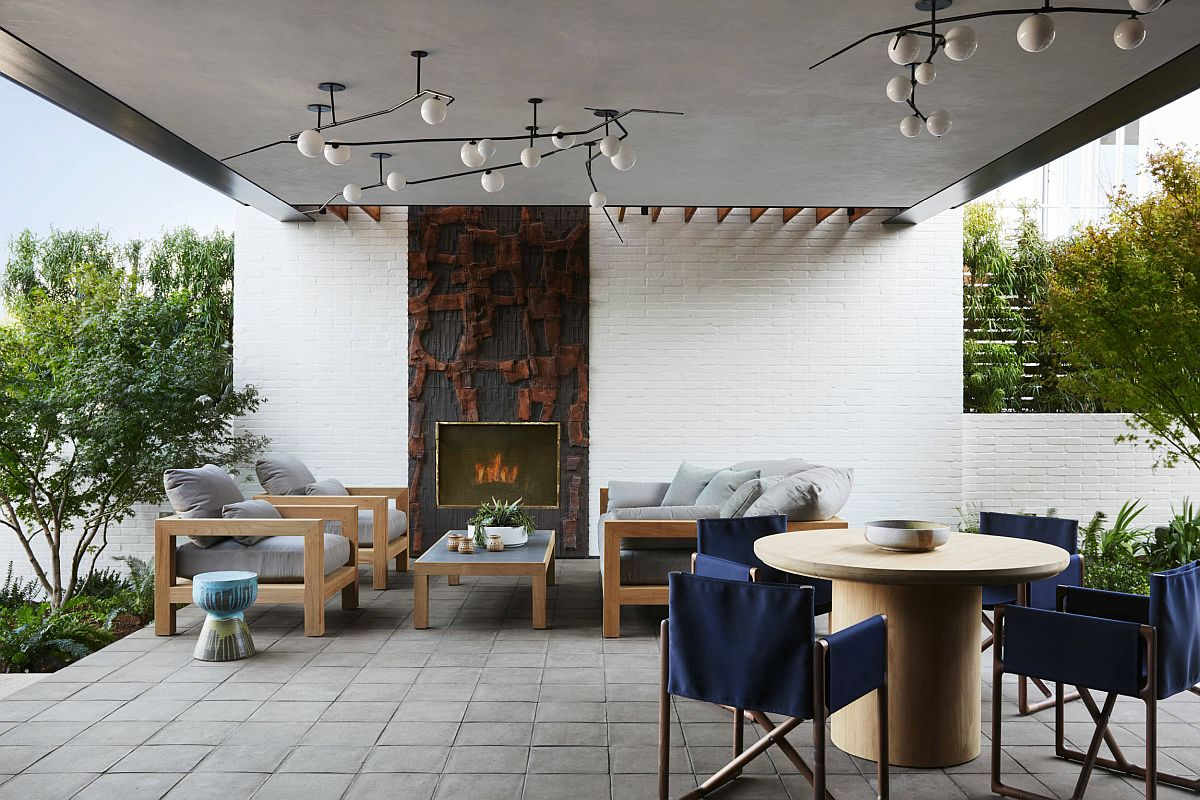 Covered outdoor area of the house with modern decor and connectivity on both sides