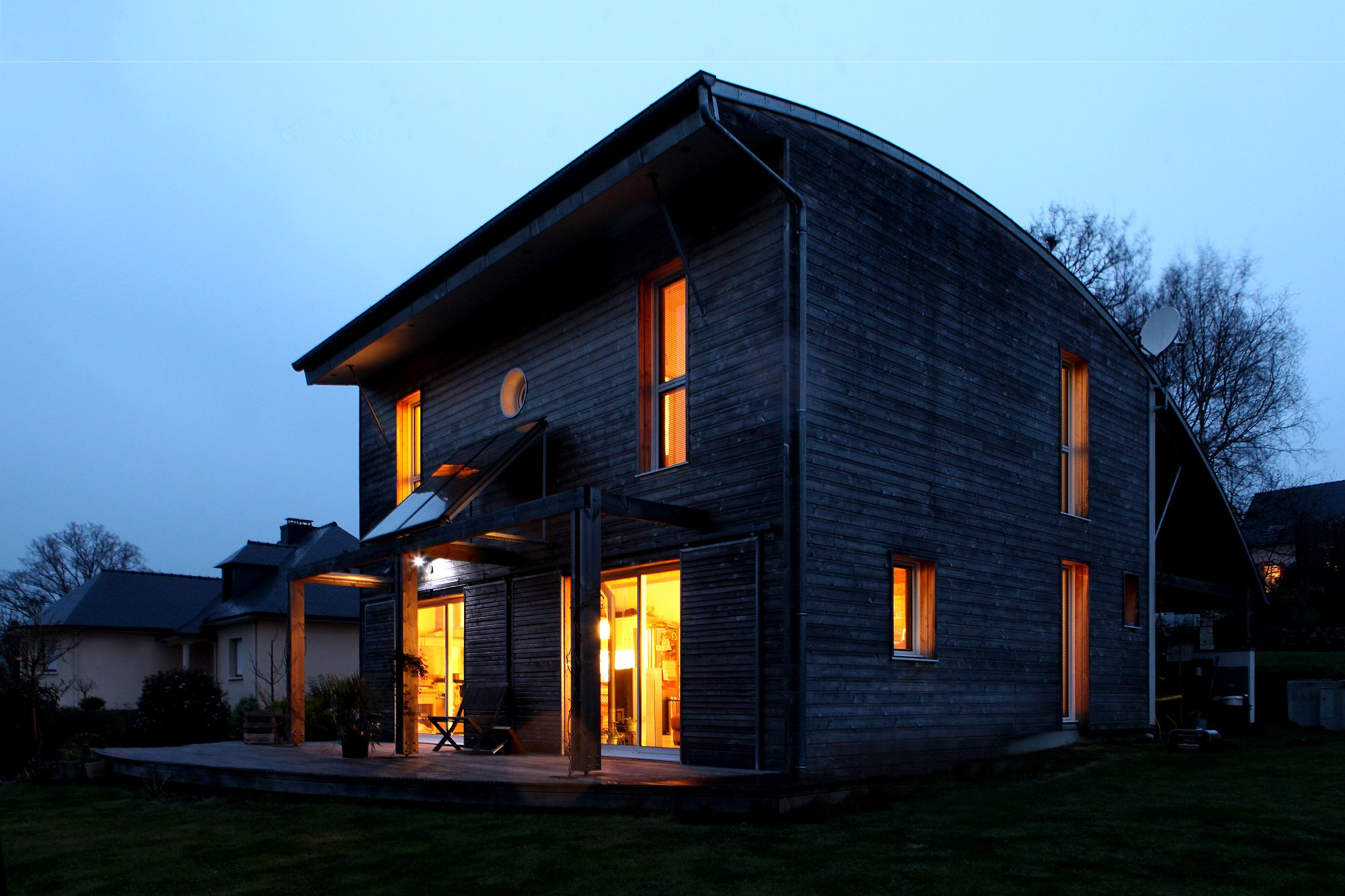 Cozy lighting takes over as the sun sets at this beautiful and sustainable French home