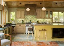 Custom-backsplash-and-floor-tiles-add-different-shades-of-green-and-yellow-in-here-even-as-the-island-steals-the-spotlight-70307-217x155