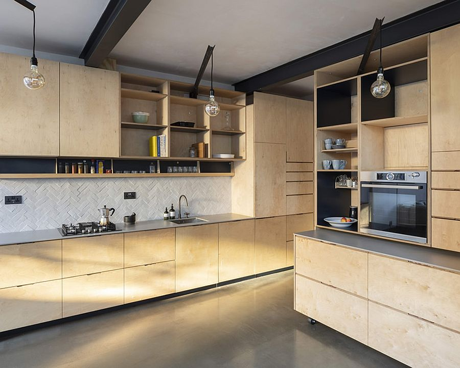 Custom birch-ply furniture, shelves and cabinets shape the new, space-conscious kitchen of the house