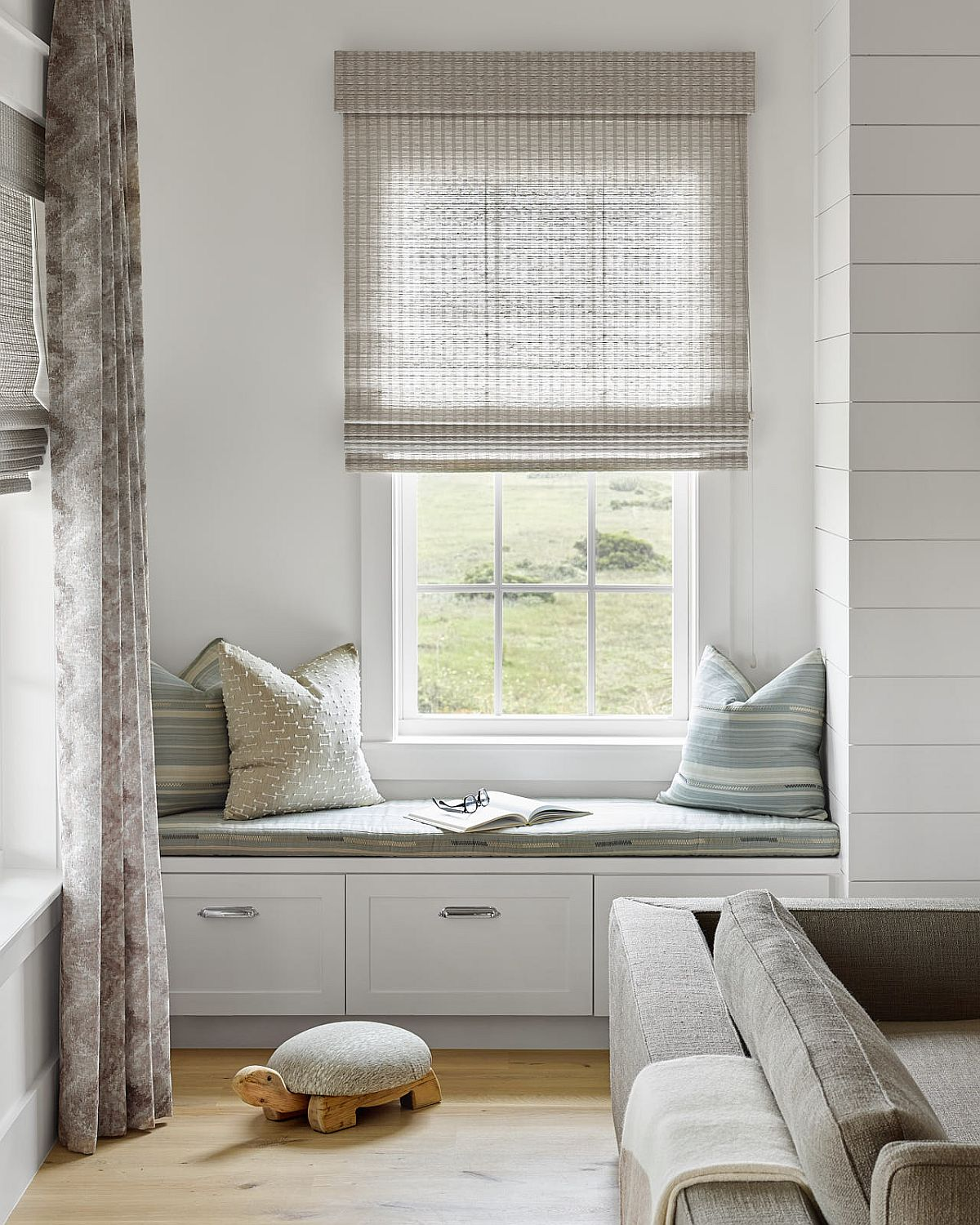Custom built-in window seat adds to the options in the living room