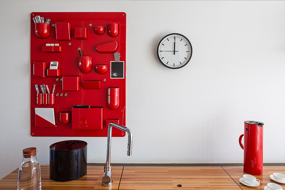 Custom wall-mounted storage solution in brilliant red for the modern kitchen
