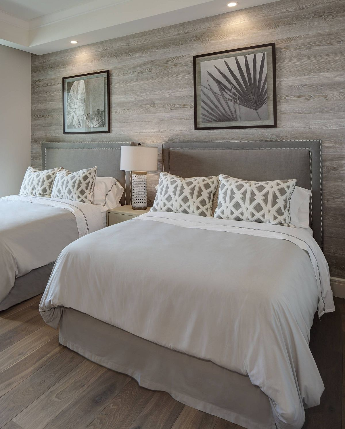 Custom wooden accent wall also brings a shade of gray to the bedroom with light gray walls