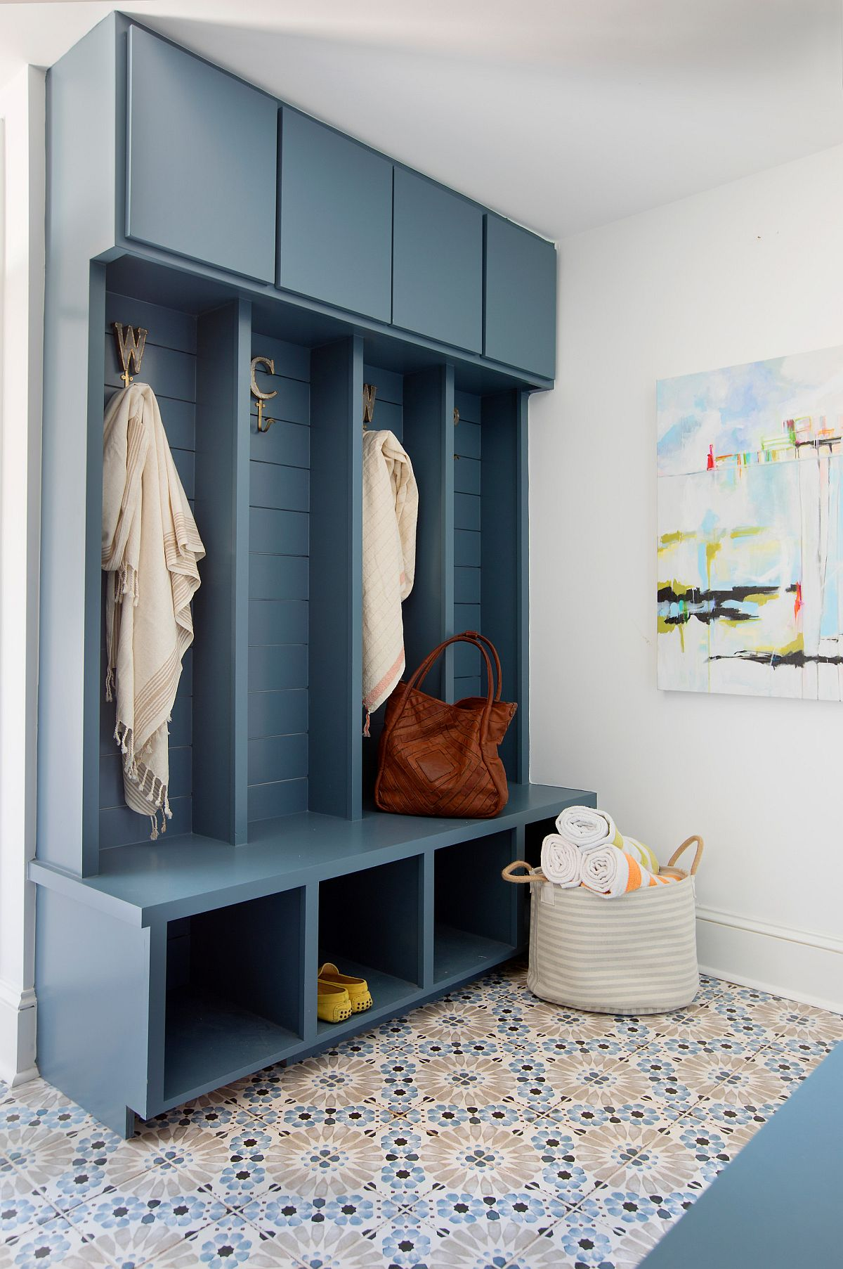 Dark blue cubbies, bench and storage units rolled into one