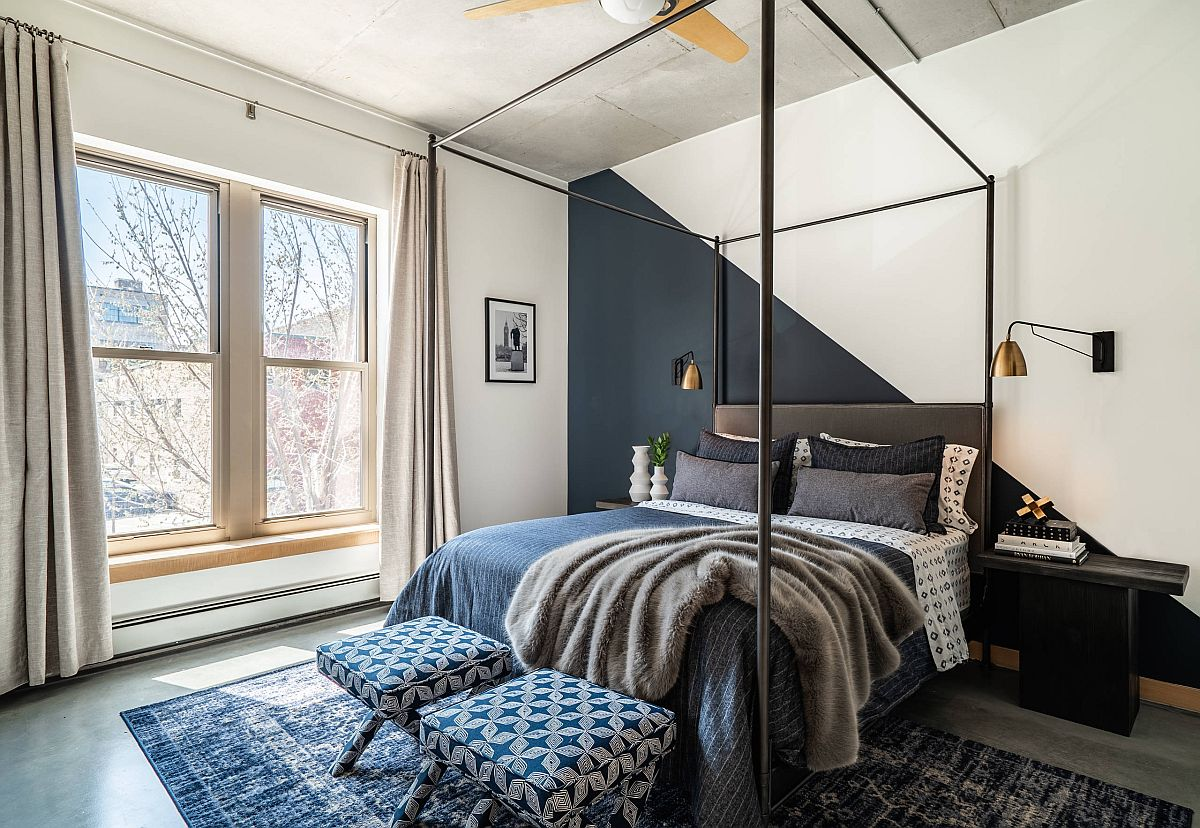 Dark gray and white accent wall in this polished bedroom moves away from the mundane