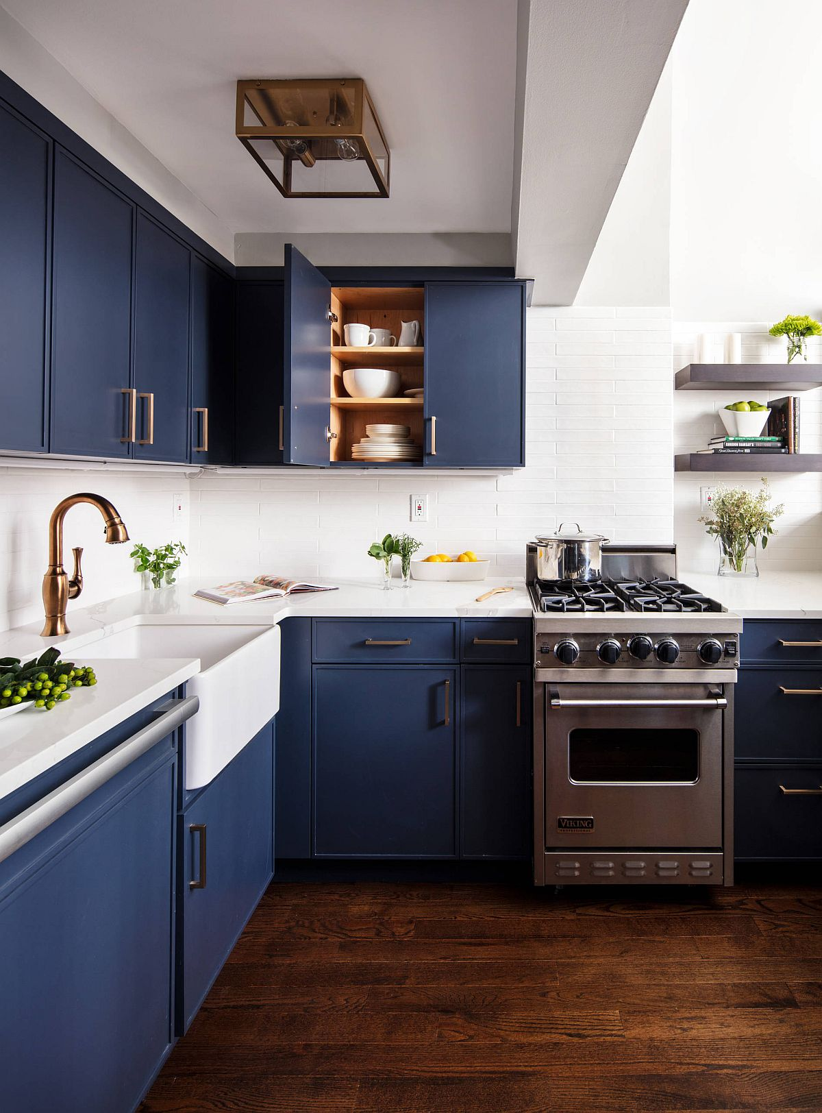 Dark navy blue and white kitchen feels both contemporary and nautical at the same time