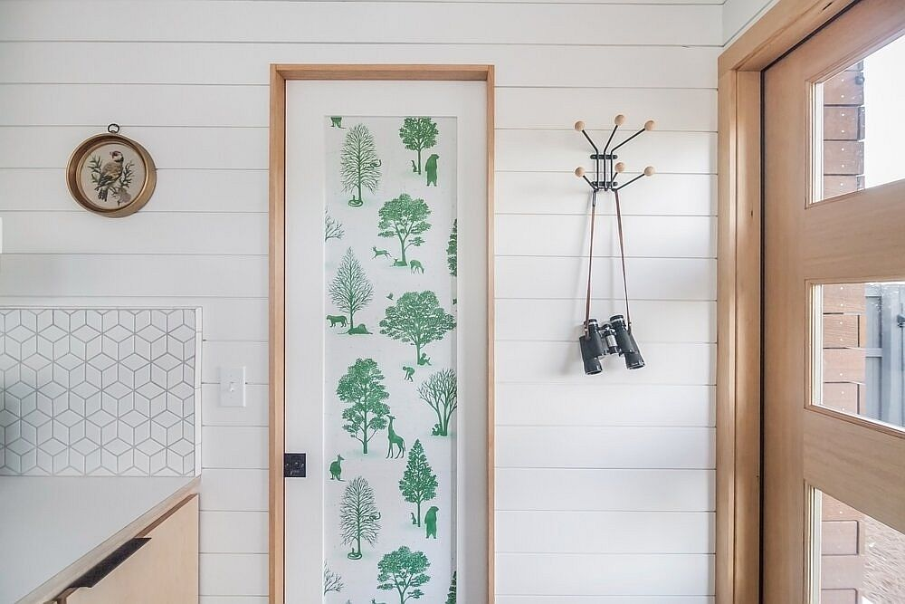Decorating the interior of the tiny house with chic botanical prints that add color without overpowering the space