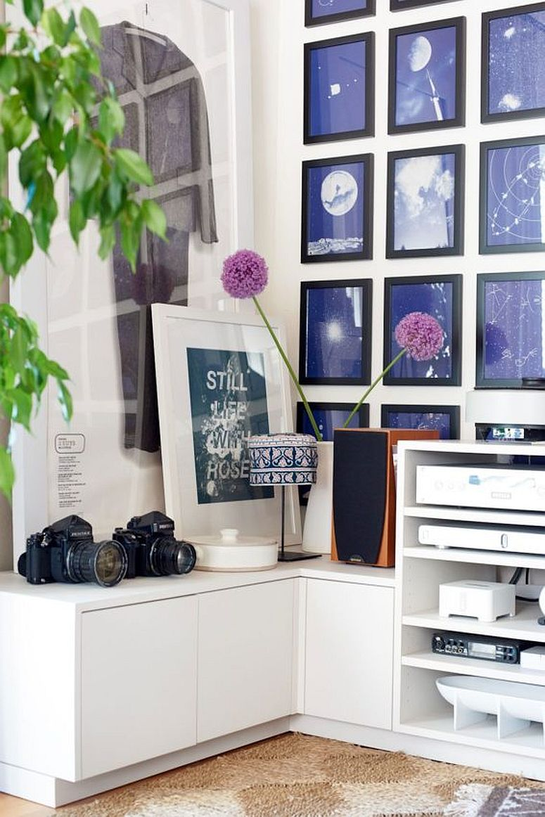 Decorating the living room wall in the corner with framed art work and photographs