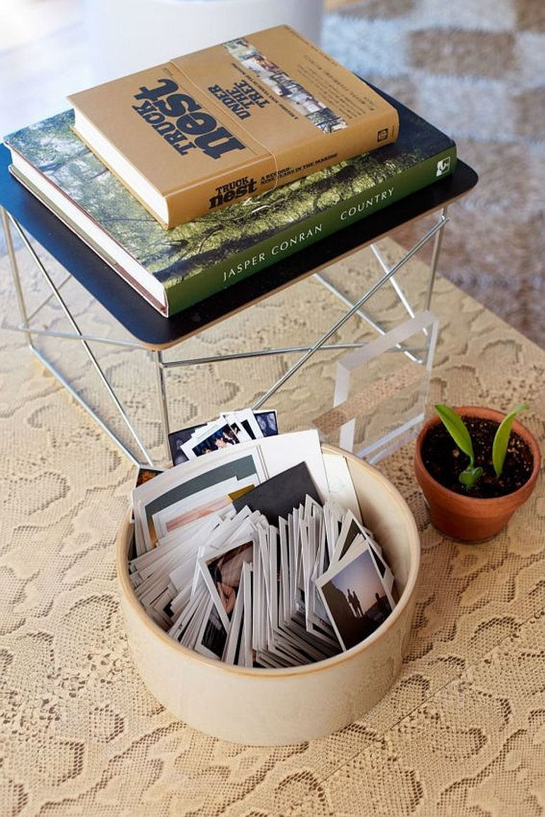 Decorating the small side table in the living room with books