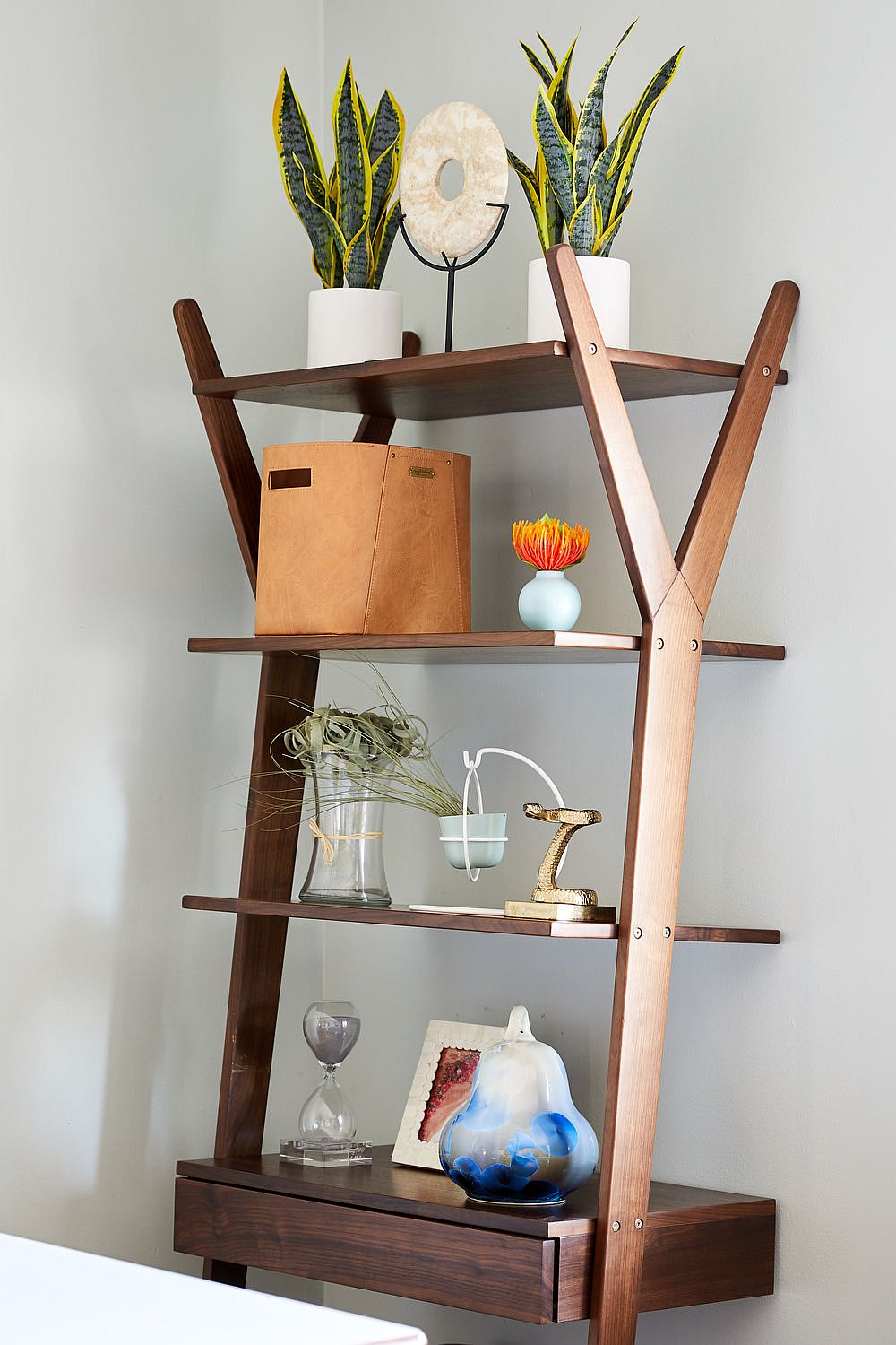 Desk and wooden shelf rolled into one and placed in the dining room corner save ample space