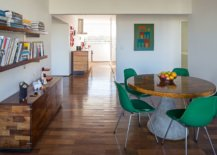 Dining-table-with-concrete-base-wooden-top-is-surrounded-by-beautiful-green-chairs-40981-217x155