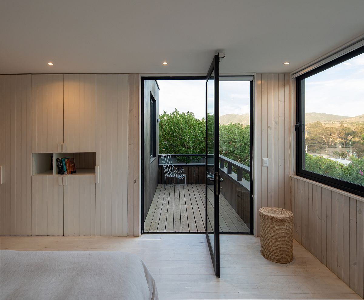Door pivots open to connect the spaciou balcony with the bedroom on the upper level